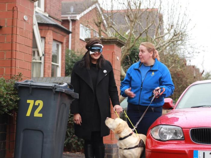 Preet Kaur Gill MP walking with trainee guide dog, Alfie in Harborne.
